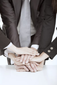 business team with hand together on the table for teamwork concept